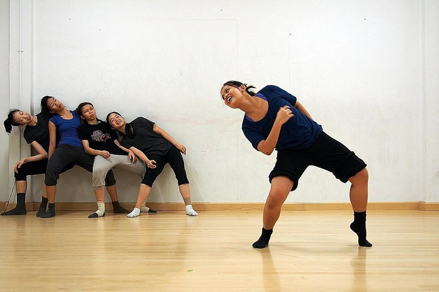 Rachel Lum (foreground) with other dancers in Pressured Pleasure.