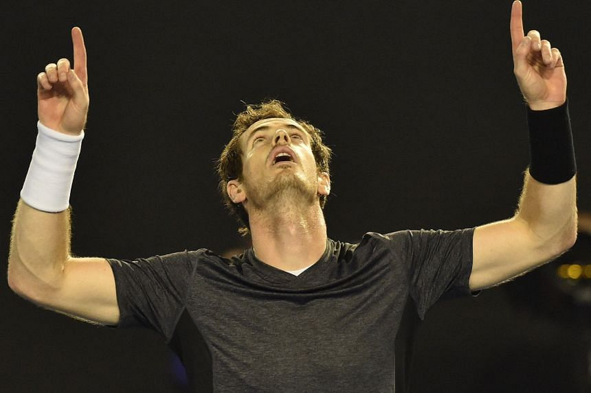 "Andy Murray celebrating his 6-4, 6-4, 7-6 (7-4) victory against Australia's Bernard Tomic at Rod Laver Arena yesterday. The Scot said he was ""drained"" after the collapse of his wife's father on Saturday."