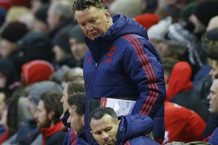 A downcast Louis van Gaal looking down at his assistant, Ryan Giggs. While the Welshman has been touted as a future manager, he will probably need to cut his teeth elsewhere before taking the hot seat at United.