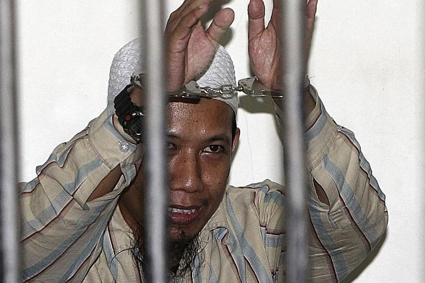 Indonesia's move to tighten visitation rights of terror inmates follows revelations that two militants involved in the Jakarta attacks visited extremist ideologue Aman Abdurrahman (left) in prison before carrying out the attacks.