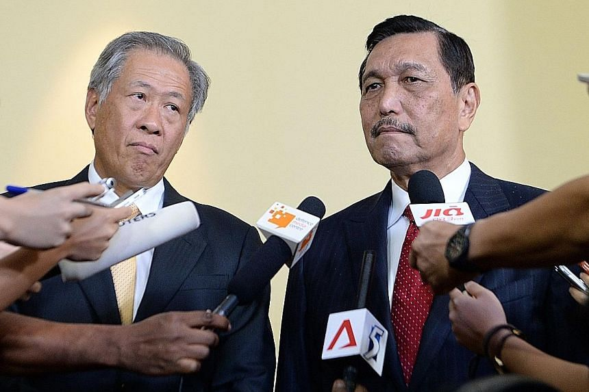 Defence Minister Ng Eng Hen (left) and Indonesia's Coordinating Minister for Political, Legal and Security Affairs Luhut Pandjaitan at the Fullerton Forum: The Shangri-La Dialogue Sherpa Meeting. Countries must work together as no nation is immune fr