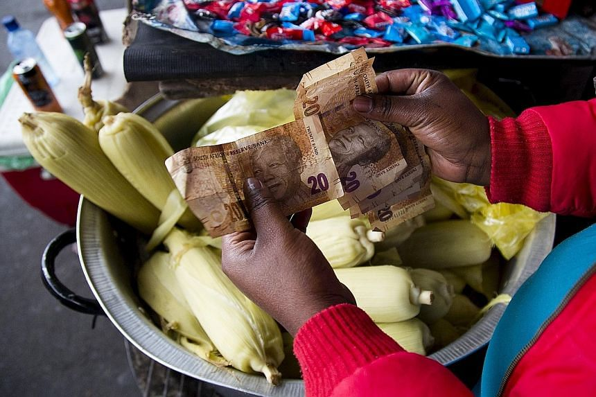 A street trader counting her South African banknotes. Weakening currencies across Africa will make it harder for many of its countries to repay China for loans used to build large infrastructure projects. The economic downturn is also reverberating a