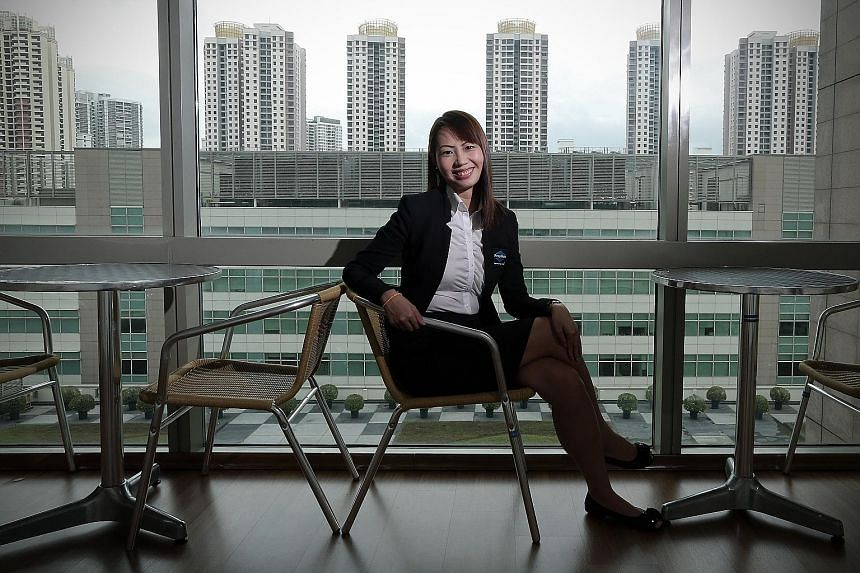 PropNex agent Joyce Tan attended one of the company's boot camps, which she says pushed her out of her comfort zone and made her realise her sales potential.