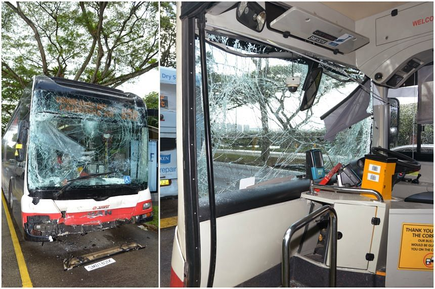The shattered front of SMRT bus service 858 (left) and its damaged interior.