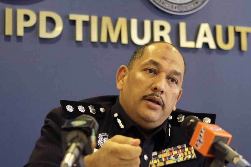 Assistant Commissioner of Police Mior Faridalatrash Wahid speaking about the case at a press conference.