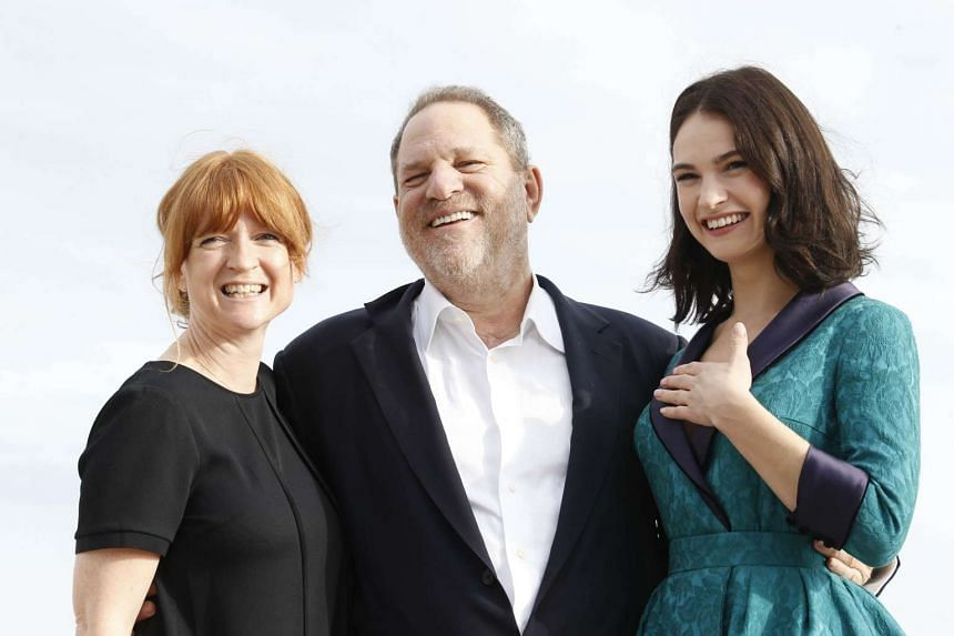 (From left) Executive producers Faith Penhale, and Harvey Weinstein, and British actress Lily James posing for the photocall of War And Peace in Cannes, France.