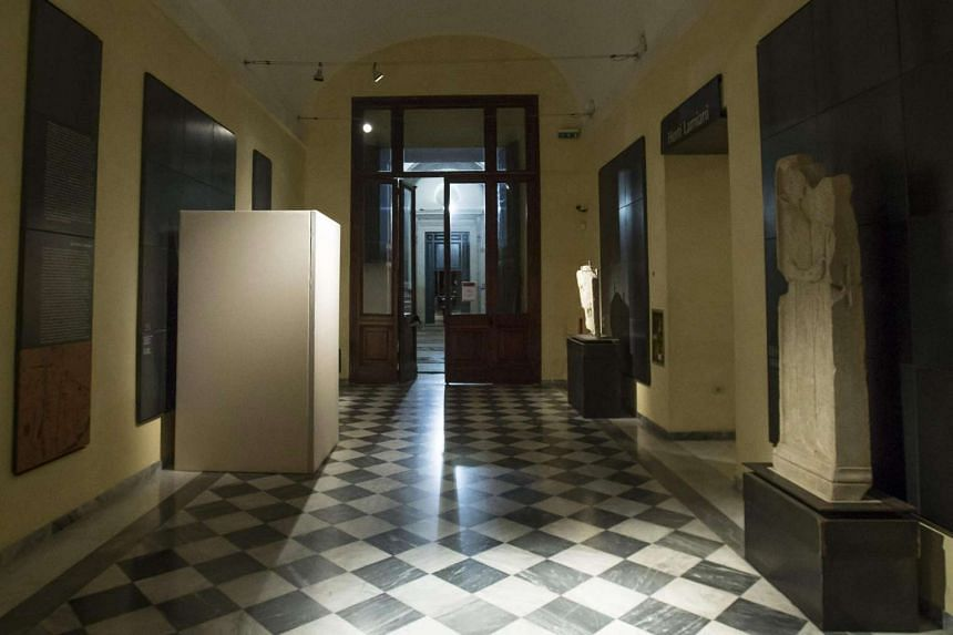 A nude statue (left) is covered with a box at the Capitoline Museum in Rome.