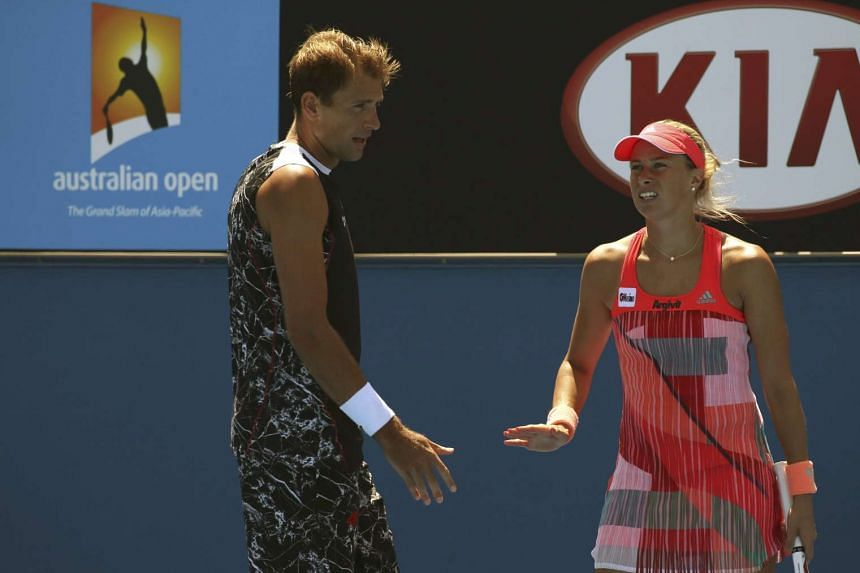 Poland's Lukasz Kubot (left) and Czech Republic's Andrea Hlavackova react during their mixed doubles match at the Australian Open tennis tournament on Monday.