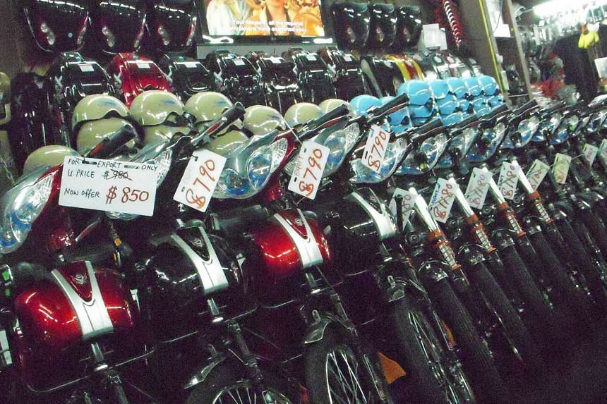 Motorised bicycles being sold at a shop in Geylang.