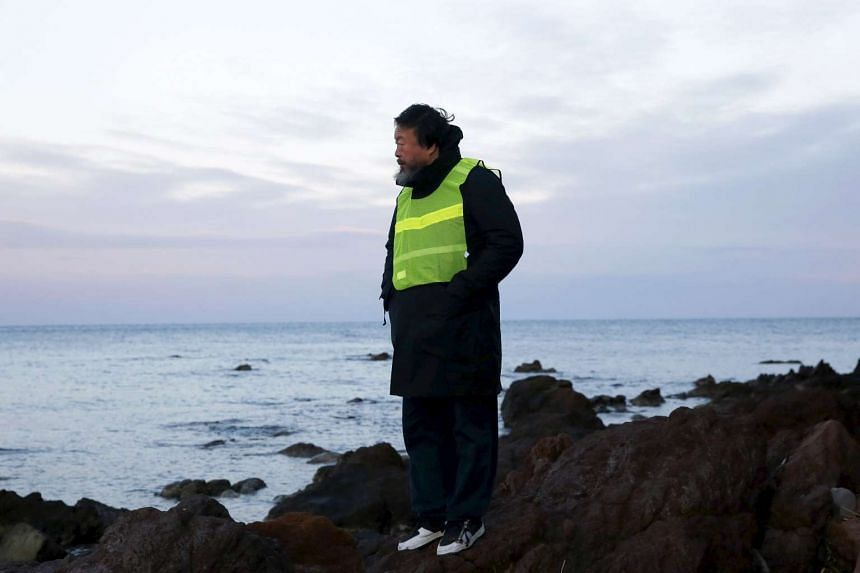 Ai Weiwei stands at a beach where refugees and migrants arrive daily on the Greek island of Lesbos on Jan 25, 2016.