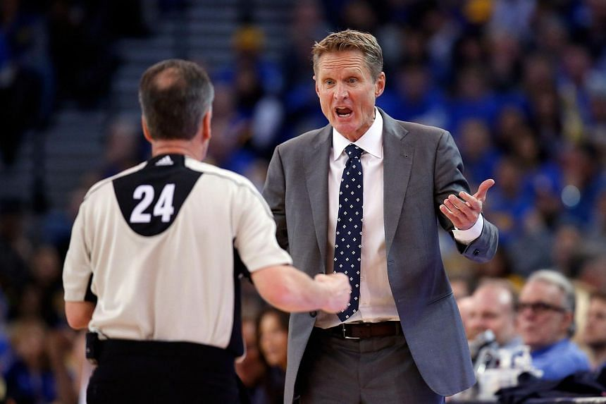 Head coach Steve Kerr of the Golden State Warriors argues a call with Mike Callahan during their game against the San Antonio Spurs.