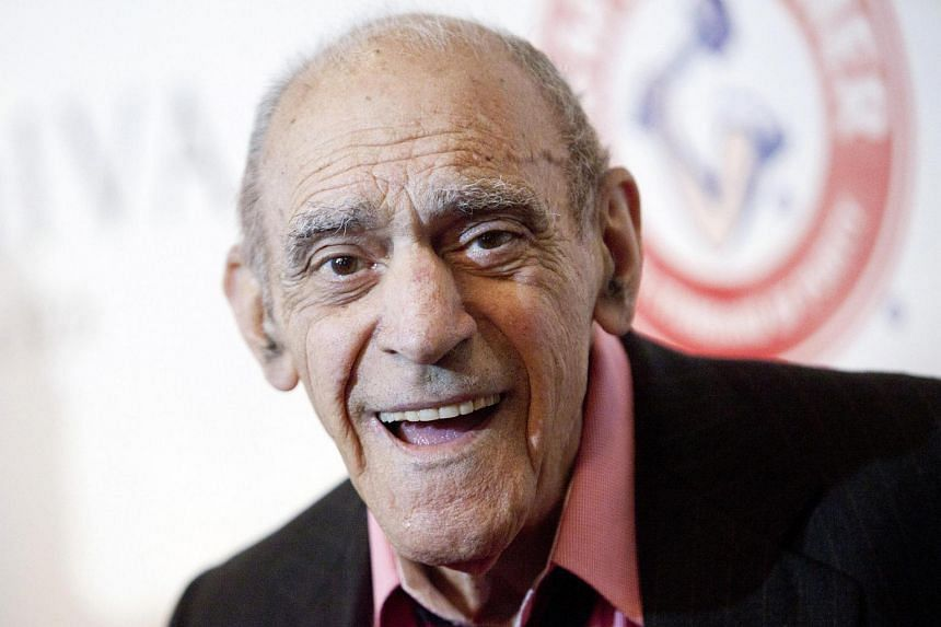 Actor Abe Vigoda smiles as he attends the Friars Club Roast of Betty White in New York in this file photo from May 16, 2012.