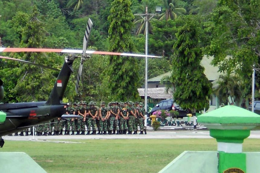Indonesian troops arriving in Poso, Central Sulawesi, to join the hunt for Santoso on Jan 25, 2016.