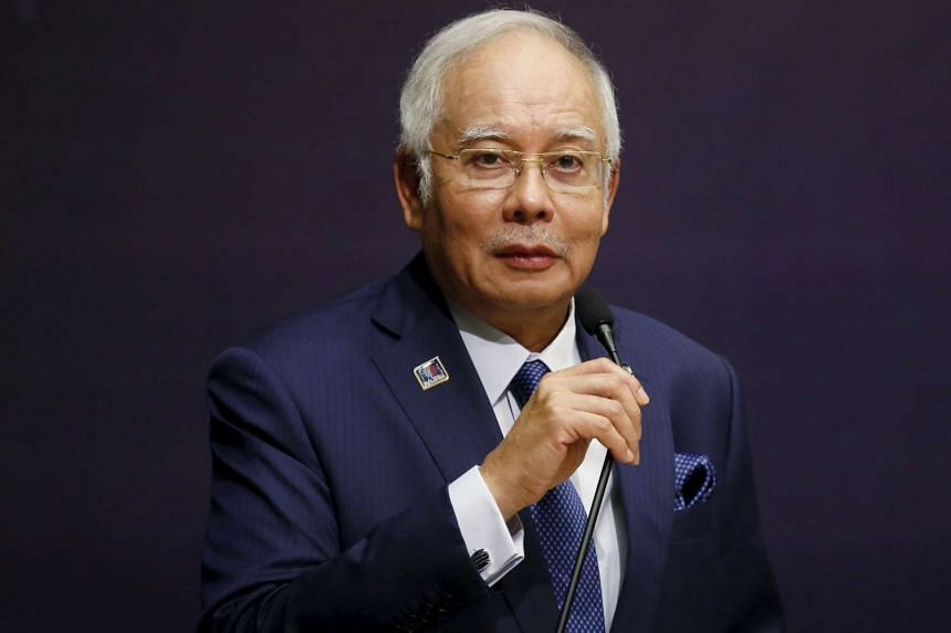 Malaysia's opposition, anti-graft activists and social media reacted with outrage after PM Najib Razak was cleared of any wrongdoing.