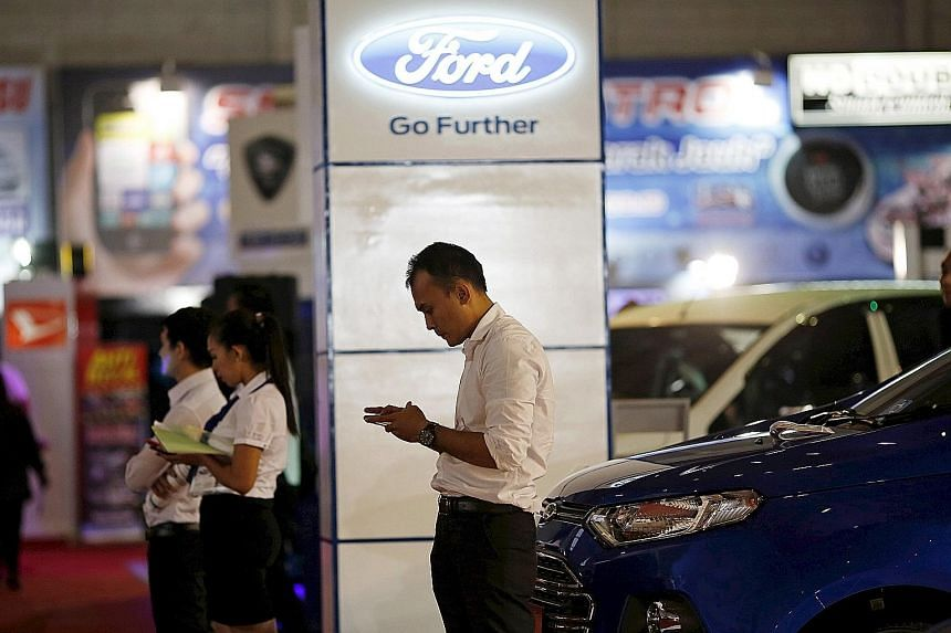 "The Ford display at the Jakarta Fair on June 30 last year. Ford said it sees ""no reasonable path to achieve sales growth"" in Indonesia and Japan."