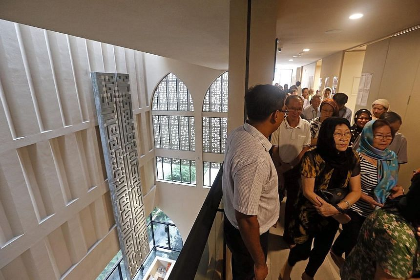 People ona guided tour in Al-Islah Mosque for residents of all races and religions last Saturday.Dr Maliki saysif there is an abrupt end to social harmony in Singapore, everyone will suffer. Every group needs to make the effort to understand the othe