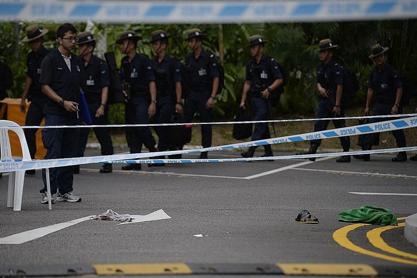 A police cordon after the incident outside the Shangri-La on May 31 last year. Two Gurkha officers standing guard outside had opened fire at a car that was accelerating towards the final line of concrete barriers after repeated warnings for the drive