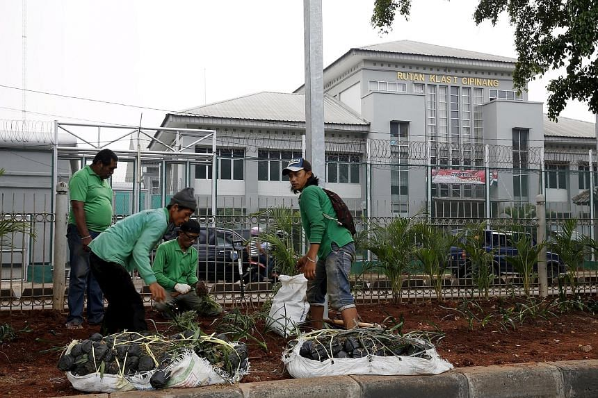 Labourers doing planting work in front of Cipinang prison, where one of the four men who carried out the Jan 14 attacks in Jakarta was influenced by fellow convict and firebrand cleric Aman Abdurrahman while an inmate. Some terrorist recidivists whom