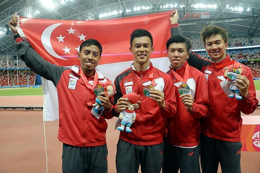 Singapore's 4x100m relay team (from left) Amirudin Jamal, Lee Cheng Wei, Gary Yeo and Calvin Kang after winning silver at the SEA Games last year. Three of them have since retired with only Kang remaining, but he has yet to train with potential new t