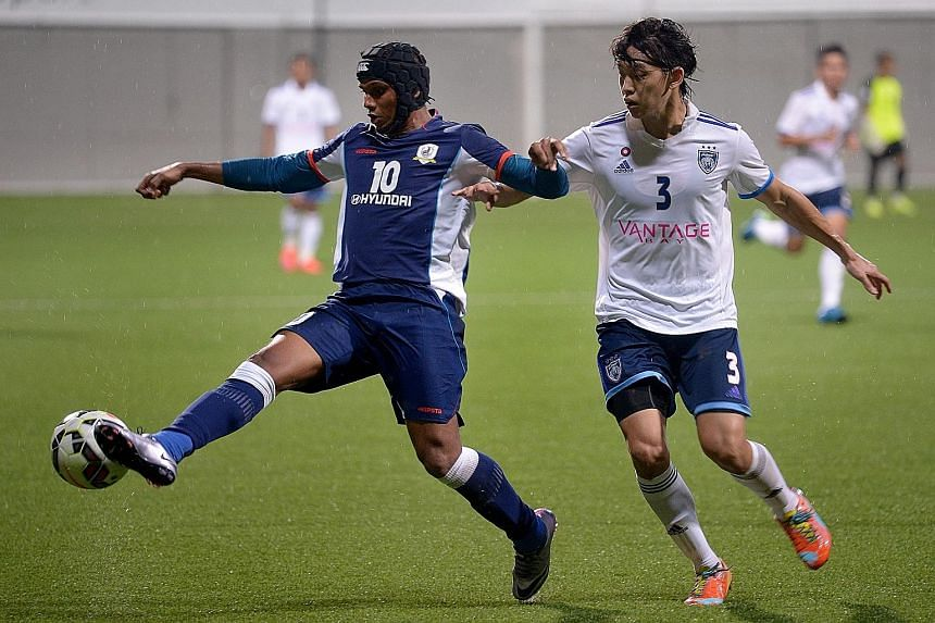 Tampines Rovers striker Fazrul Nawaz (left) in action for former club Warriors FC in last season's S-League. He will be looking to get off the mark tonight when Tampines take on Indian side Mohun Bagan in Kolkata for a place in the next qualifying ro