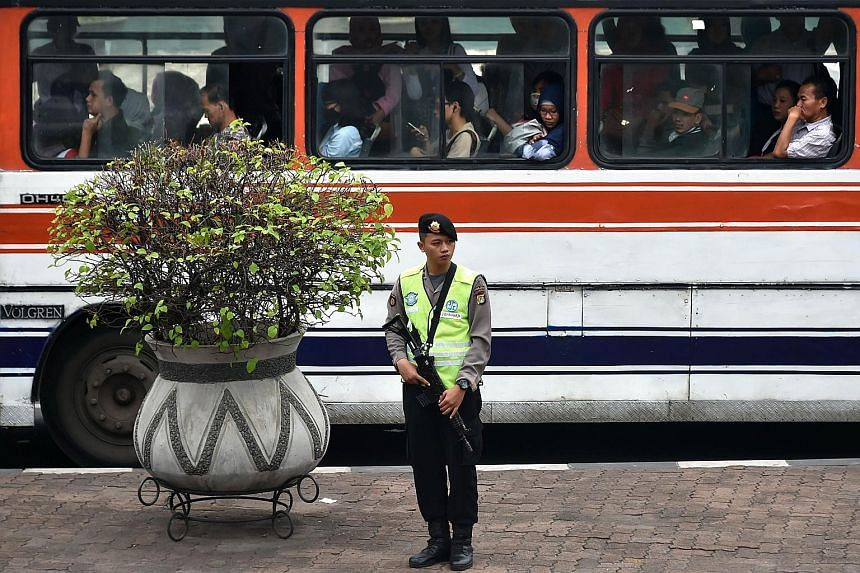 """An armed policeman standing guard in Jakarta last Friday. The police's call for more funding to support its war on terror follows the Jan 14 attack by four local militants in Central Jakarta. """"This is for anticipating threats from terrorists, regardl"""