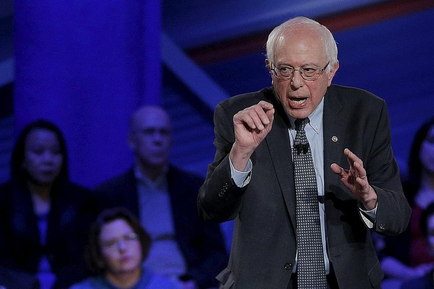 """Senator Bernie Sanders is focusing his campaign on pledges to reduce social inequality and curb Wall Street excesses. Mr Martin O'Malley says the nation's political gridlock cannot be solved through """"old ideologies or old names"""". Mrs Hillary Clinton"""