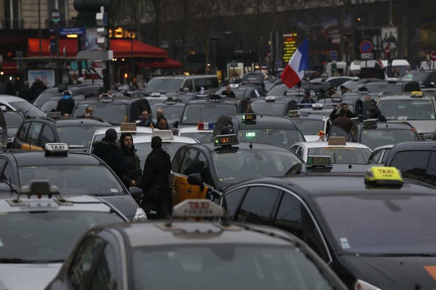 Taxi drivers block the traffic.