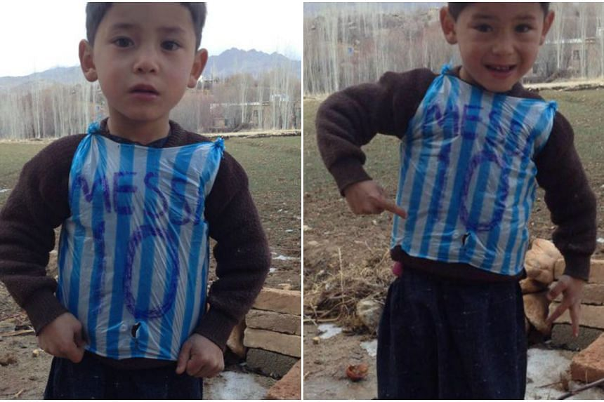 save off 6c8ba 60f89 Mystery of boy seen in Messi plastic bag jersey solved ...