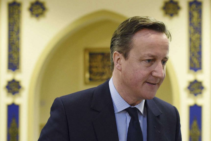 Mr David Cameron visits a mosque in Leeds, Britain, on Jan 18, 2016.