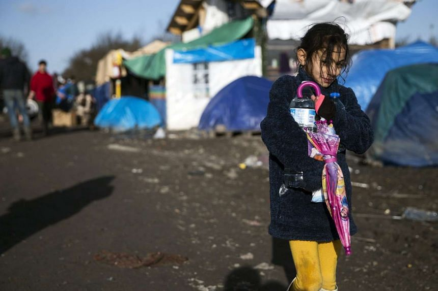 A young Kurdish girl in the makeshift migrant camp in Grande-Synthe near Dunkirk.
