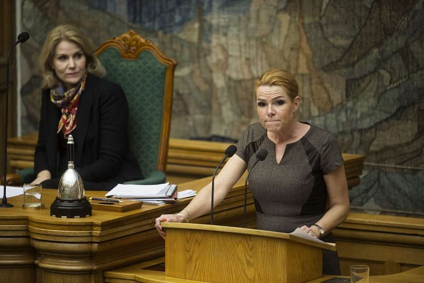 Danish Minister for Immigration, Integration and Housing Inger Stoejberg (right) addresses Parliament.