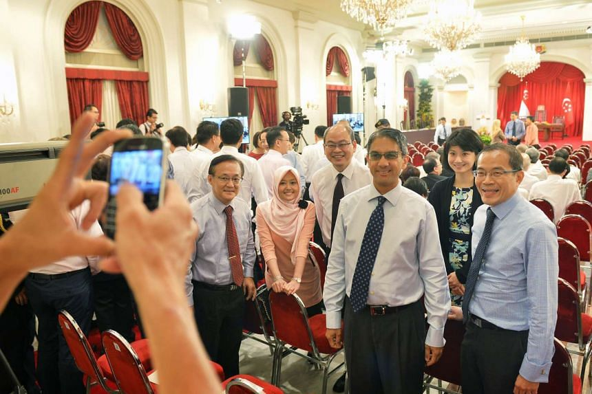 New NCMPs Mr Dennis Tan (far right) and Mr Leon Perera (second from right) posing for a photo with constituency MPs.