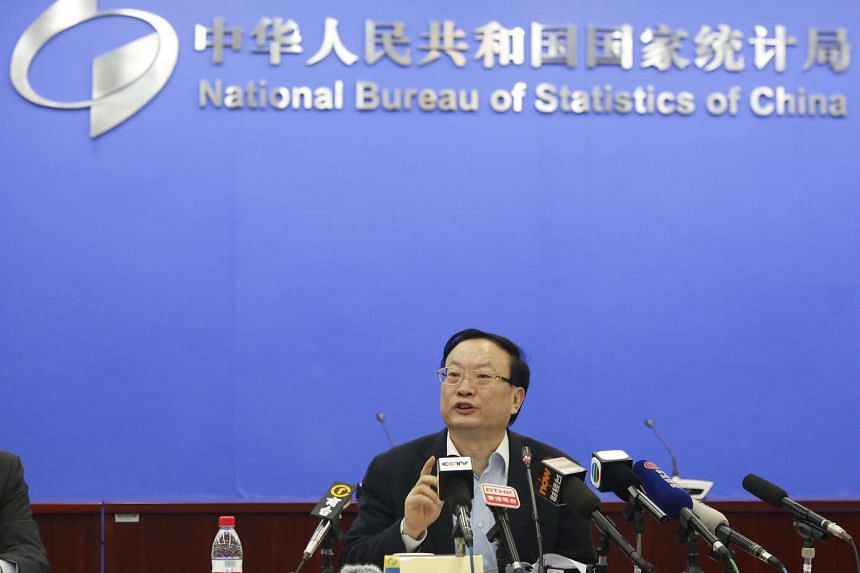 China's National Bureau of Statistics chief Wang Baoan holding a press briefing on the economy yesterday. Just hours later, the anti-corruption watchdog announced that he was being investigated.