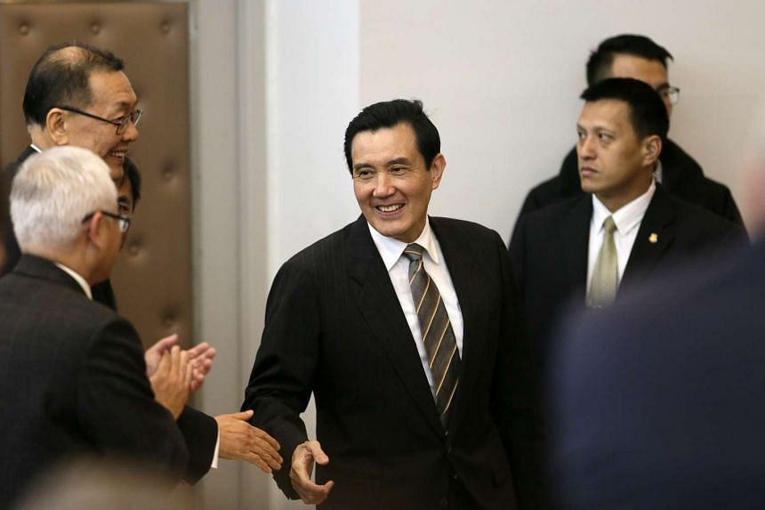 Ma Ying-jeou (centre) is greeted by participants before he addresses attendees about the South China islands during a Scientific International Seminar.