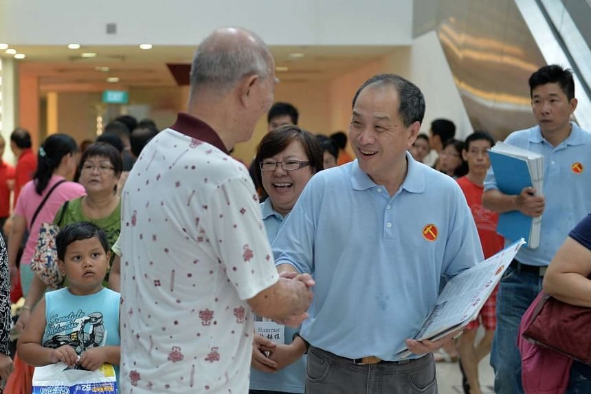 Mr Low Thia Khiang speaking to a shopper at Rivervale Plaza during a walkabout on July 26, 2015.