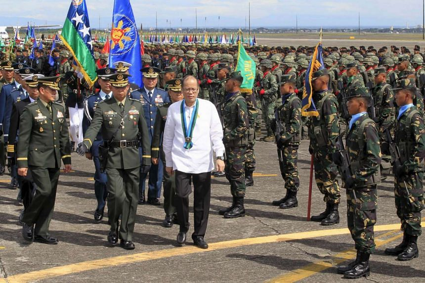 Philippines' President Benigno Aquino reviews a military platoon at the 80th founding anniversary of the Armed Forces of the Philippines, on Dec 21, 2015.
