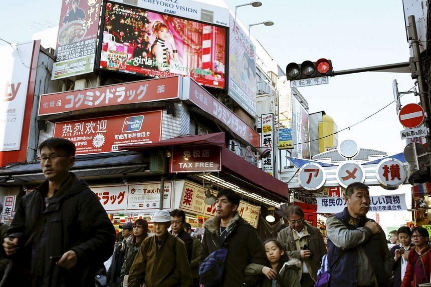 People crowd Ameyoko market as they shop in Tokyo, Japan, on Dec 30, 2015.