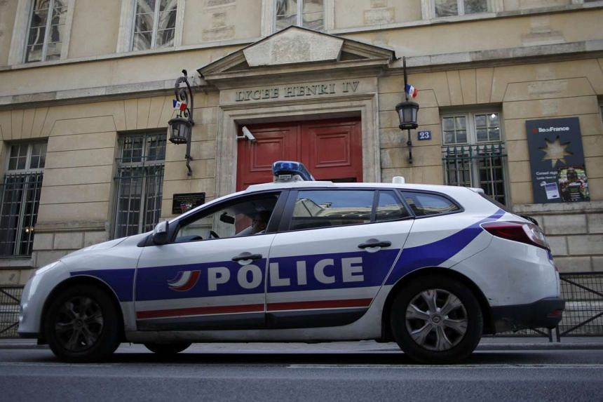 A French police car is seen outside the Lycee Henri IV after five high schools received bomb threats in Paris, France, on Jan 26, 2016.