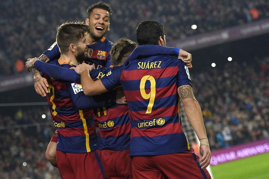 Gerard Pique (left) celebrates with his teammates after scoring a goal during the Spanish Copa del Rey football match between FC Barcelona vs Athletic Bilbao.