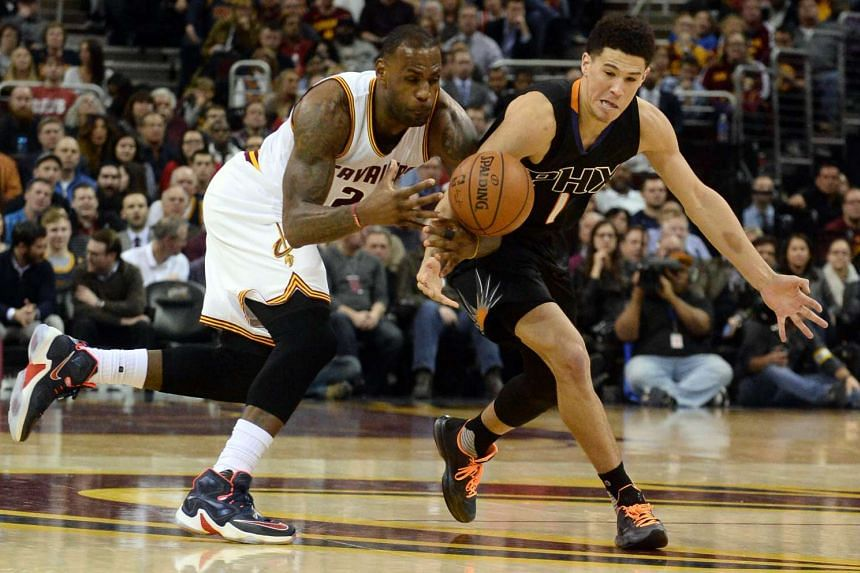 Cleveland Cavaliers' LeBron James (left) and Phoenix Suns' Devin Booker during their match at Quicken Loans Arena on Jan 27,2016.
