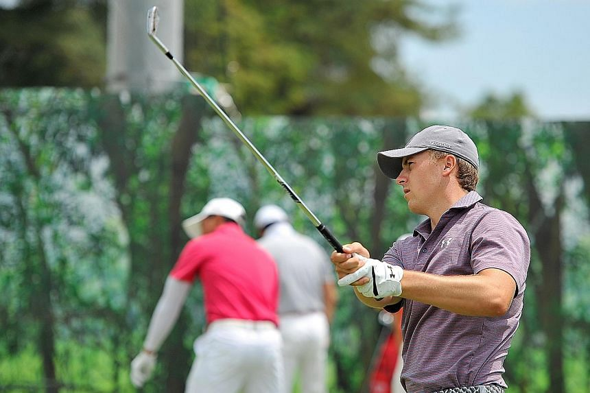 Reigning world No. 1 Jordan Spieth testing his mettle at the challenging Serapong Course yesterday. The Texan golfer, who has never competed in the Republic before, is favoured to win the 50th edition of the Singapore Open which gets under way today.