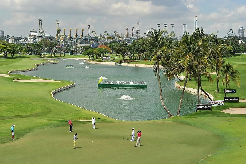 Golfers at the 18th hole of the Serapong Course yesterday. Former British Open champion and Europe's Ryder Cup captain Darren Clarke pointed out that each of the course's 18 holes presents a unique challenge.