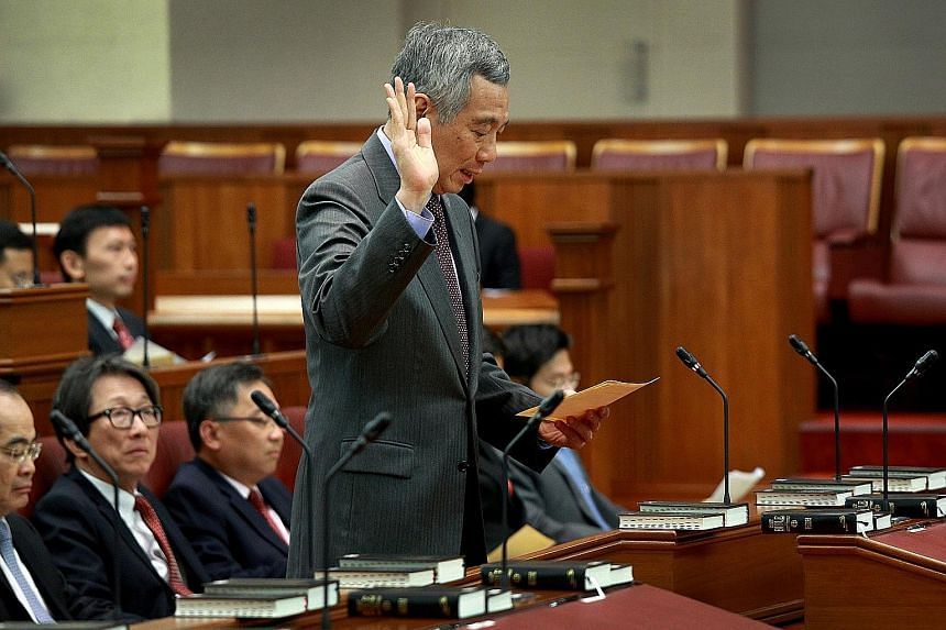 Prime Minister Lee Hsien Loong taking the oath of allegiance during the swearing-in ceremony at the opening of the 13th Parliament on Jan 15.