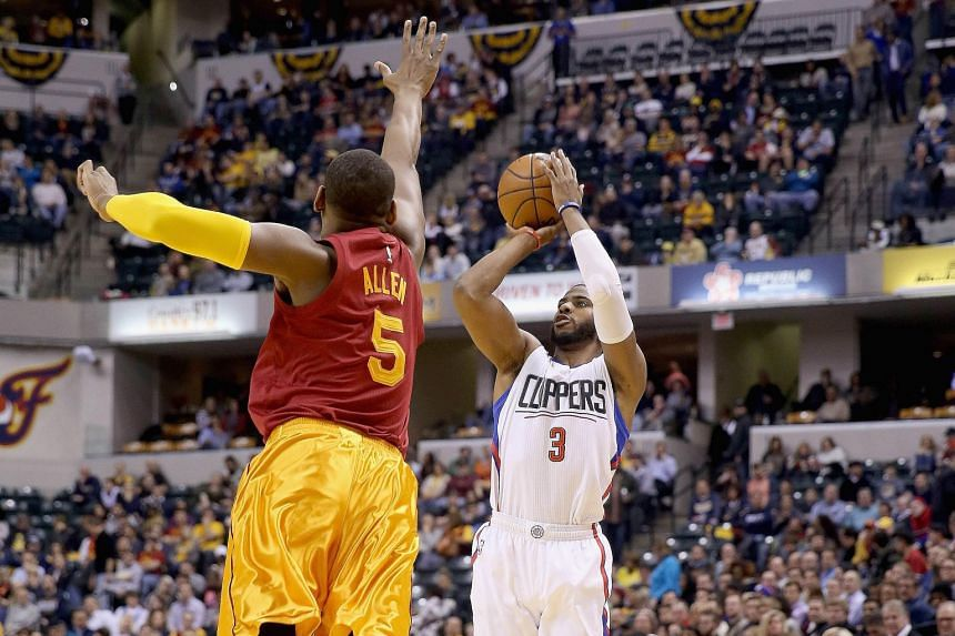 Chris Paul (right) of the Los Angeles Clippers shooting in the game against the Indiana Pacers. The Clippers won 91-89.