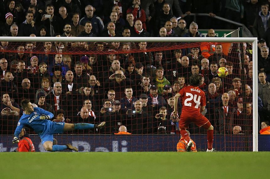 Liverpool's Joe Allen (above) scoring the decisive penalty to win the shoot-out (6-5) against Stoke City in their League Cup semi-final second leg. Reds goalkeeper Simon Mignolet (below) also played a crucial role, saving from Peter Crouch and Marc M