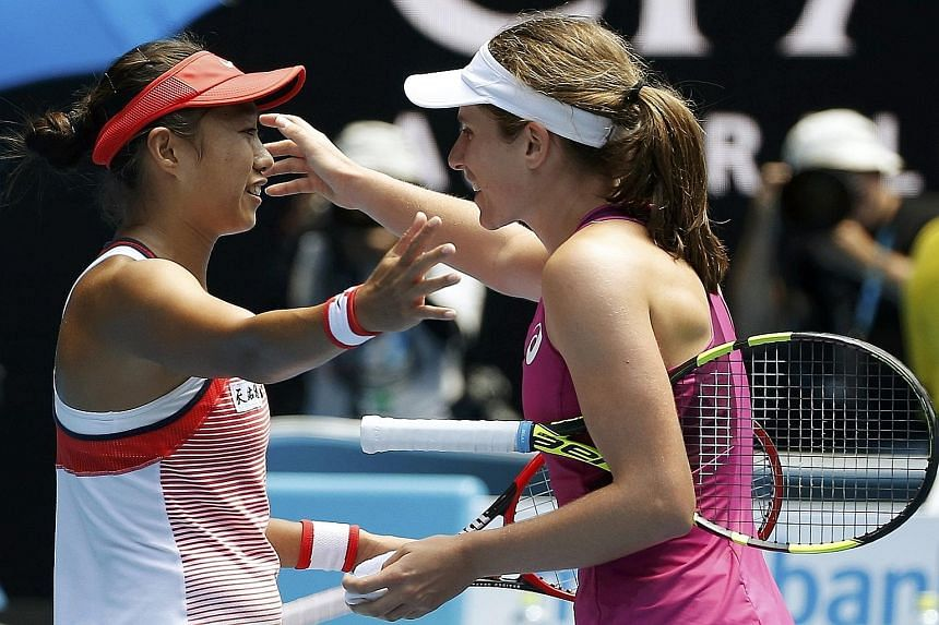 Zhang Shuai (left), the improbable heroine who brought an endearing spark to the women's draw at the Australian Open, embracing Johanna Konta after losing 4-6, 1-6 to the Briton in the quarter-finals yesterday.