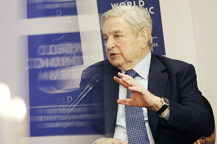 Mr George Soros, billionaire and founder of Soros Fund Management, seen here at the World Economic Forum last week, pointed to deflation and excessive debt as reasons for China's slowdown.