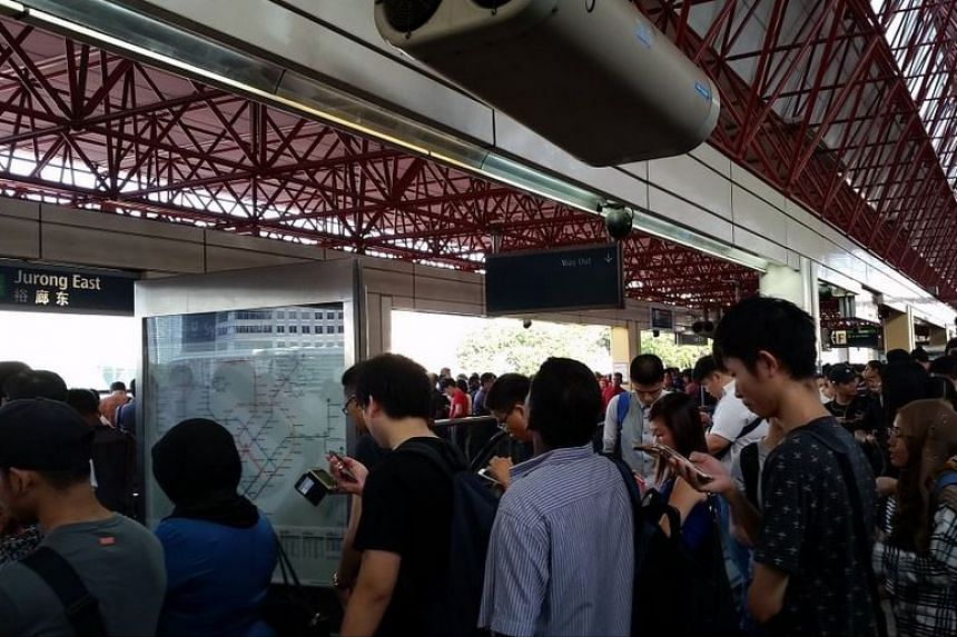 The crowd waiting on the train platform at Jurong East MRT station.