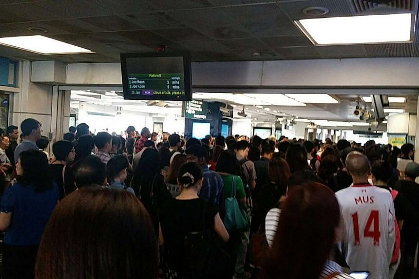 The crowd waiting to enter Boon Lay MRT station.
