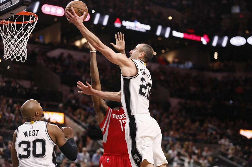 San Antonio Spurs guard Manu Ginobili (right) going for a layup while being guarded by Houston Rockets guard James Harden (centre) on Jan 27, 2016.